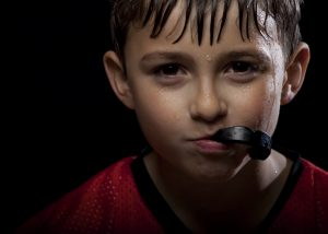 A custom mouthguard from your dentist in Marysville protects your teeth from hard hits to the mouth.