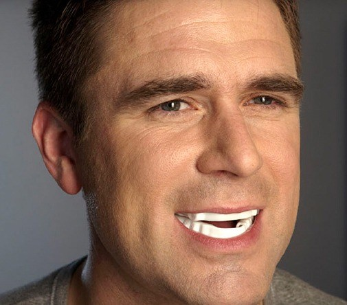 man with oral appliance in mouth