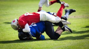 football players in a tackle