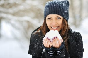Woman smiling in the snow.