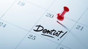 a calendar with dentist appointment reminder