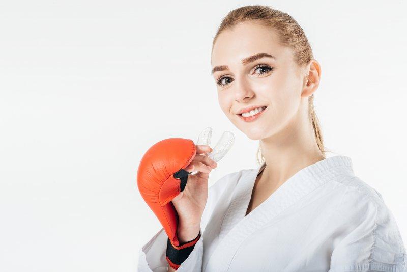 Woman wearing custom sports guard from dentist