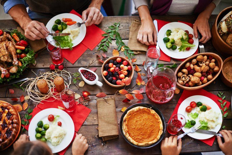 a table full of savory and sugary foods prepared for Thanksgiving