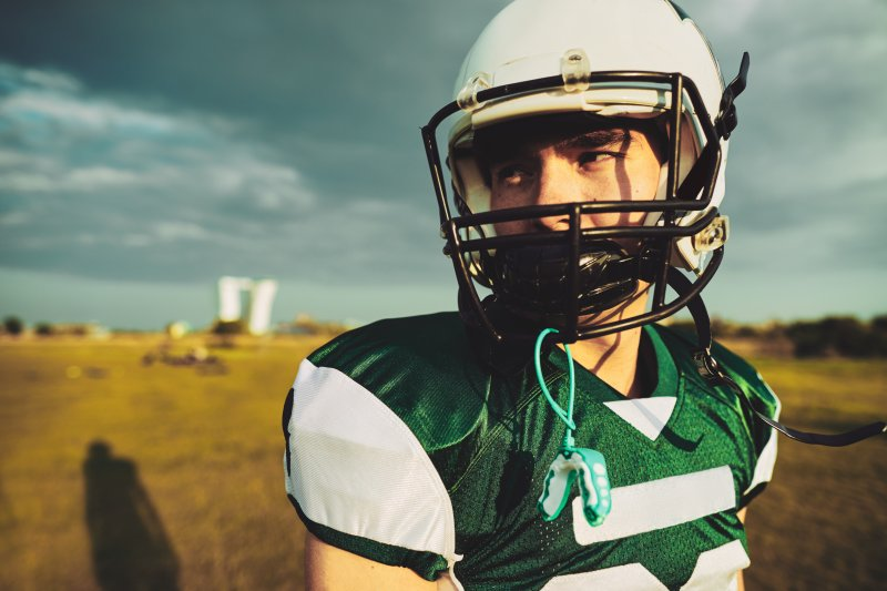 football player with a custom mouthguard