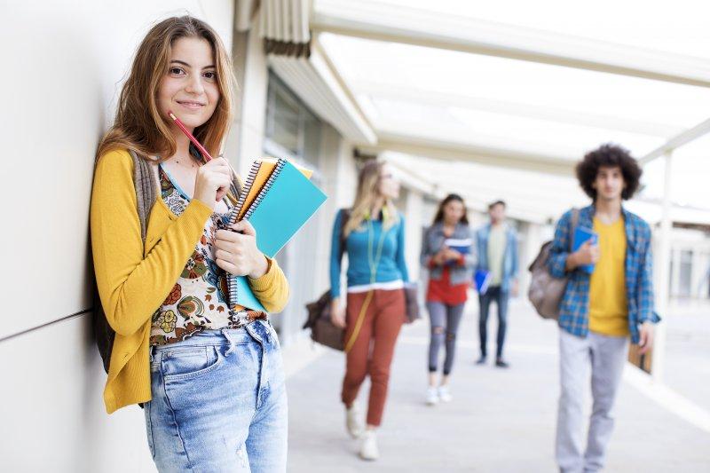 young Invisalign teen in school